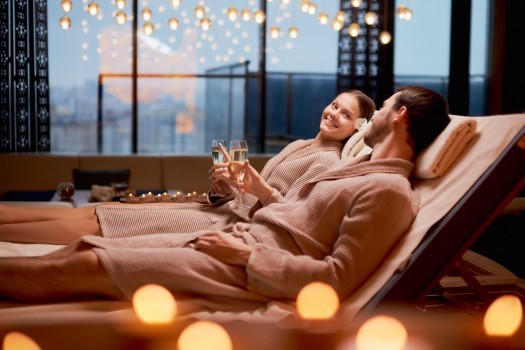 Couple enjoying champagne while relaxing in a spa.